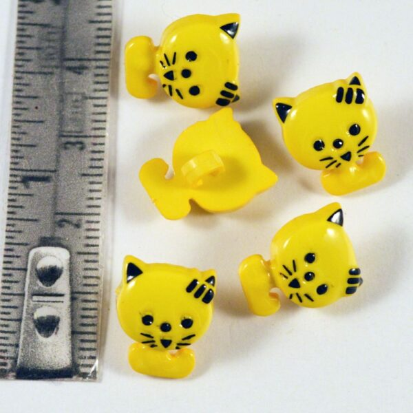 Kitten shaped buttons with black outlining Yellow
